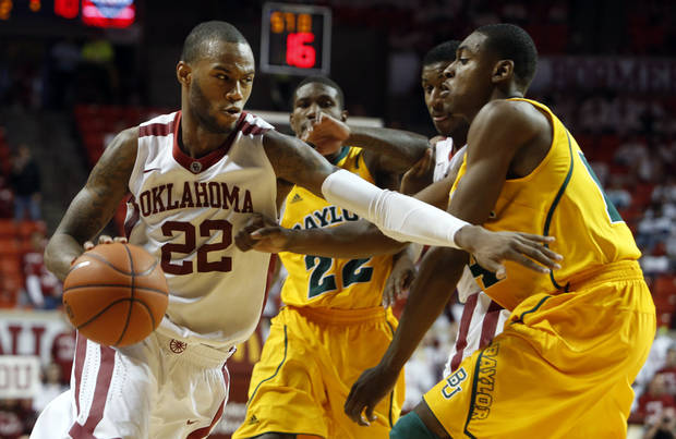Oklahoma Sooners' Amath M'Baye (22) drives by Baylor Bears' Deuce Bello (14) in the second half as the University of Oklahoma Sooners (OU) men defeat the Baylor University Bears (BU) 90-76 in NCAA, college basketball at The Lloyd Noble Center on Saturday, Feb. 23, 2013  in Norman, Okla. Photo by Steve Sisney, The Oklahoman