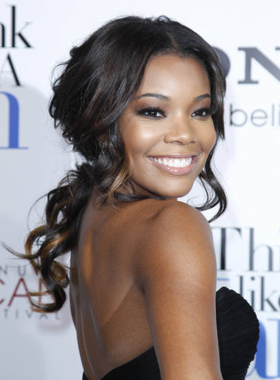 "Cast member Gabrielle Union poses at The Pan African Film & Arts Festival's opening night premiere of Screen Gems' ""Think Like a Man"" in Los Angeles, Thursday, Feb. 9, 2012. (AP Photo/Danny Moloshok) ORG XMIT: CADM111"