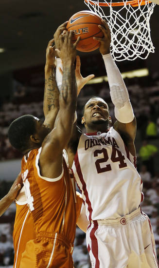 Oklahoma's Romero Osby (24) rebounds the ball against Texas' Julien Lewis (14) during a men's college basketball game between the University of Oklahoma and the University of Texas at the Lloyd Noble Center in Norman, Okla., Monday, Jan. 21, 2013. OU won, 73-67. Photo by Nate Billings, The Oklahoman