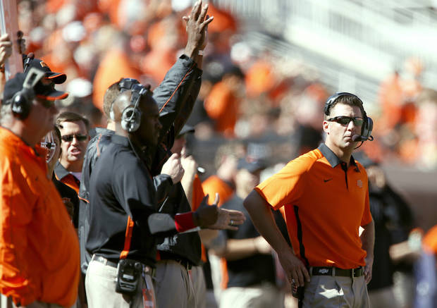 With Mike Gundy, right, or a committee calling plays, the Cowboys� offense could be a bit slower against Purdue in the Heart of Dallas Bowl. Photo by Sarah Phipps, The Oklahoman