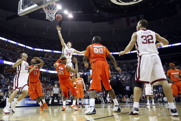 Oklahoma's Cade Davis (34) shoots the ball over the top of Syracuse's Arinze Onuaku (21) during the first half of the NCAA Men's Basketball Regional at the FedEx Forum on Friday, March 27, 2009, in Memphis, Tenn.