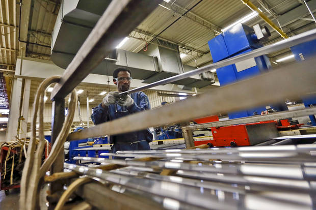 Osman Shangab sorts aluminum strips to be used in production of items at the MD Building Products plant on Wednesday, Jan. 2, 2013, in Oklahoma City, Okla. Photo by Chris Landsberger, The Oklahoman