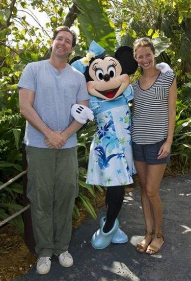 In this photo provided by Disney, actor and director Ed Burns poses with his wife, model and filmmaker Christy Turlington, and a person dressed as the character Minnie Mouse on Friday, April 20, 2012, at Disney's Polynesian Resort at Walt Disney World in Lake Buena Vista, Fla. (AP Photo/Disney, Gene Duncan)