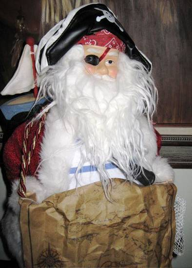 AHOY MATEYS...Santa in the Meredith home held the treasure map and  wore his eye patch and pirate's hat. (Photo by Helen Ford Wallace).