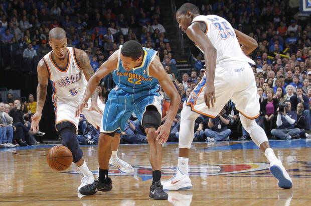 Oklahoma City Thunder&#039;s Eric Maynor (6) and Kevin Durant (35) defend New Orleans Hornets&#039; Brian Roberts (22) during the NBA basketball game between the Oklahoma CIty Thunder and the New Orleans Hornets at the Chesapeake Energy Arena on Wednesday, Dec. 12, 2012, in Oklahoma City, Okla.   Photo by Chris Landsberger, The Oklahoman