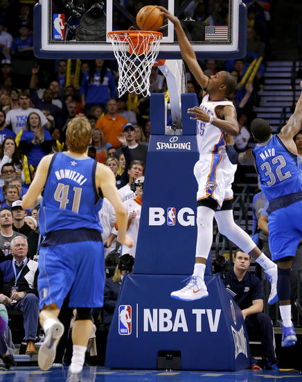 Oklahoma City's Kevin Durant (35) dunks the ball beside Dallas' O.J. Mayo (32) during an NBA basketball game between the Oklahoma City Thunder and the Dallas Mavericks at Chesapeake Energy Arena in Oklahoma City, Thursday, Dec. 27, 2012.  Oklahoma City won 111-105. Photo by Bryan Terry, The Oklahoman