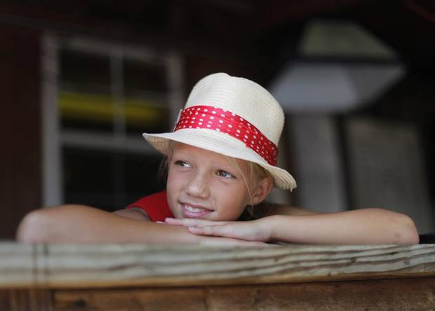CHILD / CHILDREN / KIDS: Brooke Teter, 10, of Wichita Kansas, watches a performance during the Woody Guthrie Folk Festival in Okemah, Okla., Thursday, July 12, 2012.  Photo by Garett Fisbeck, The Oklahoman