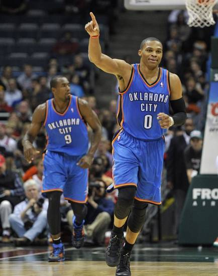 Oklahoma City Thunder's Russell Westbrook (0) celebrates a basket against the Milwaukee Bucks late in the second half of an NBA basketball game Saturday, Nov. 16, 2013, in Milwaukee. The Thunder defeated the Bucks 92-79. (AP)