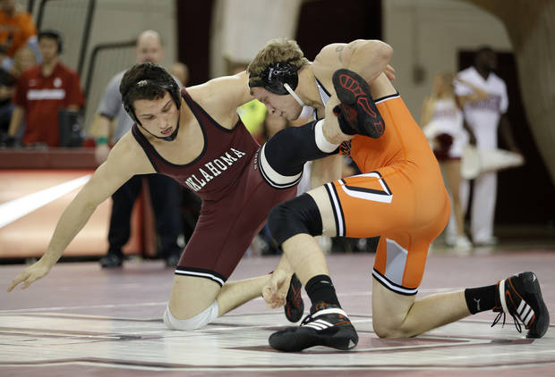 OU's Brad Johnson wrestles OSU's Blake Rosholt during the wrestling match between Oklahoma University and Oklahoma State University at McCasland Field House in Norman, Okla.,Sunday, Dec. 9, 2012.  Photo by Garett Fisbeck, For The Oklahoman