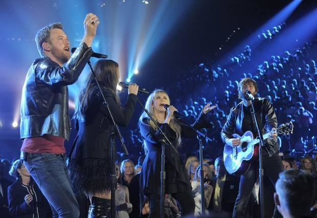 Stevie Nicks, second from right, and from left, Charles Kelley, Hillary Scott and Dave Haywood, of the musical group Lady Antebellum, perform on stage at the 49th annual Academy of Country Music Awards at the MGM Grand Garden Arena on Sunday, April 6, 2014, in Las Vegas. (AP)