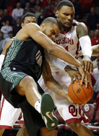 Oklahoma's Romero Osby (24) and Ohio's Reggie Keely (30) battle for a rebound during a NCAA college basketball game between the University of Oklahoma (OU) and Ohio at the Lloyd Noble Center in Norman, Saturday, Dec. 29, 2012. Photo by Bryan Terry, The Oklahoman