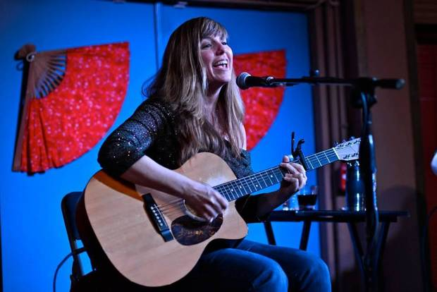 Okemah red dirt singer-songwriter Susan Herndon plays a 2013 show at the Blue Door. Photo by M. Tim Blake.