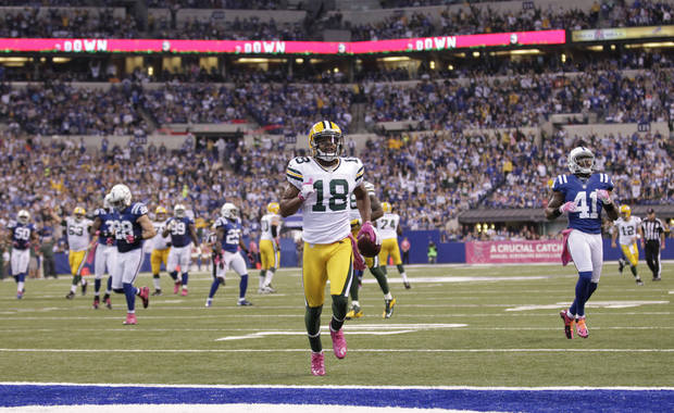 Green Bay Packers wide receiver Randall Cobb (18) goes in for a 31-yard touchdown reception during the first half of an NFL football game against the Indianapolis Colts in Indianapolis, Sunday, Oct. 7, 2012. (AP Photo/AJ Mast)
