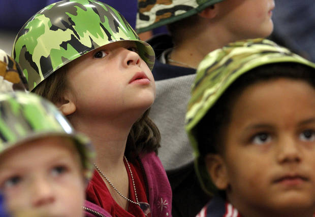 Julia Guitron sits with other kindergarten students during a patriotic-themed Veteran's Day assembly Friday morning, Nov. 9, 2012, at Schwartz Elementary School at SE 104 and Anderson Road.   Many students wore red, white and blue or camouflage to honor veterans.      Photo by Jim Beckel, The Oklahoman