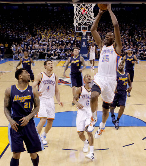 Oklahoma City's Kevin Durant (35) goes up for the dunk beside Denver's Wilson Chandler (21) during the NBA basketball game between the Denver Nuggets and the Oklahoma City Thunder in the first round of the NBA playoffs at the Oklahoma City Arena, Wednesday, April 27, 2011. Photo by Bryan Terry, The Oklahoman
