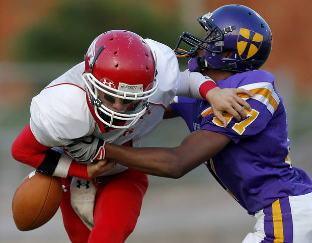 Western Heights' James Lewis fumbles the ball as Northwest Classen's Terrance Bias brings him down during a high school football game at Taft Stadium in Oklahoma City, Thursday, September 20, 2012. Photo by Bryan Terry, The Oklahoman