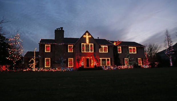 Christmas lights adorn a home on Drury Lane in Nichols Hills. Photo by Nate Billings, The Oklahoman