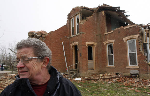 Tom Yeagel looks around at damage in front of his house that was destroyed after a tornado on Friday hit the village of Moscow, Ohio, Sunday, March 4, 2012. (AP Photo/David Kohl) ORG XMIT: OHDK102