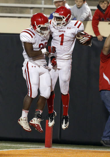 Davis' Michael Nowden (1) and Chase Taliaferro celebrate a touchdown during the Class 2A high school football championships between Davis and Oklahoma Christian School at Boone Pickens Stadium in Stillwater, Okla.,  Saturday,Dec. 8, 2012. Photo by Sarah Phipps, The Oklahoman