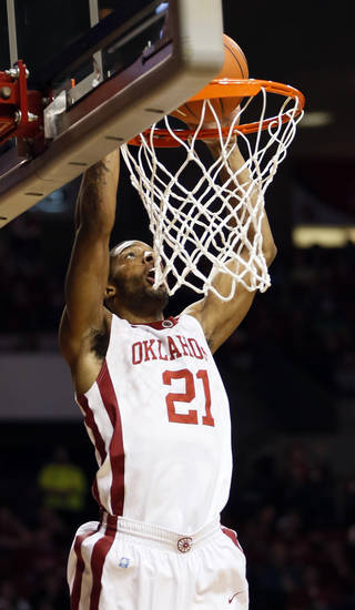 Oklahoma's Cameron Clark (21) dunks the ball during an NCAA men's basketball game between the University of Oklahoma (OU) and Kansas State at the Lloyd Noble Center in Norman, Okla., Saturday, Feb. 2, 2013. Photo by Nate Billings, The Oklahoman