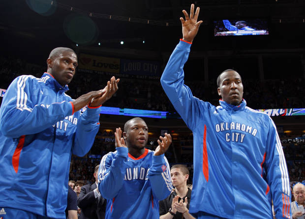 L.A. LAKERS: Oklahoma City's Nazr Mohammed (8),  Nate Robinson (3) and Kendrick Perkins (5) are introduced before the NBA basketball game between the Oklahoma City Thunder and the Los Angeles Lakers, Sunday, Feb. 27, 2011, at the Oklahoma City Arena. Photo by Sarah Phipps, The Oklahoman  ORG XMIT: KOD
