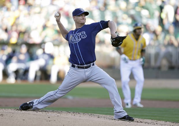 Tampa Bay Rays starting pitcher Alex Cobb throws against the Oakland Athletics in the first inning of their baseball game Saturday, Aug. 31, 2013, in Oakland, Calif. (AP Photo/Eric Risberg)