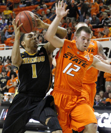 Missouri's Phil Pressey (1) goes past Oklahoma State's Keiton Page (12) during an NCAA college basketball game between the Oklahoma State University Cowboys (OSU) and the Missouri Tigers (MU) at Gallagher-Iba Arena in Stillwater, Okla., Wednesday, Jan. 25, 2012. Photo by Bryan Terry, The Oklahoman