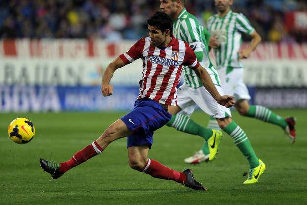 Atletico de Madrid's Diego Costa from Brazil, scores his goal during a Spanish La Liga soccer match against Betis at the Vicente Calderon stadium in Madrid, Spain, Sunday, Oct. 27, 2013. (AP Photo/Andres Kudacki)