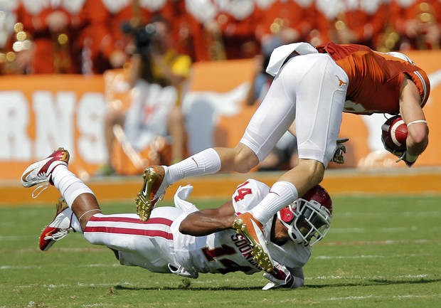 OU's Aaron Colvin (14) brings down UT's Jaxon Shipley (8) during the Red River Rivalry college football game between the University of Oklahoma Sooners (OU) and the University of Texas Longhorns (UT) at the Cotton Bowl Stadium in Dallas, Saturday, Oct. 12, 2013. Photo by Chris Landsberger, The Oklahoman