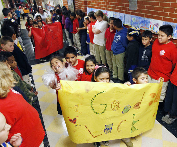 Students at Mark Twain Elementary School put on a parade Friday to cheer on their older peers ahead of state testing.  PHOTO by Paul Hellstern, The Oklahoman