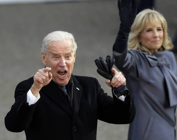 Vice President Joe Biden reacts with his wife, Jill, as they walk down Pennsylvania Avenue en route to the White House, Monday, Jan. 21, 2013, in Washington. Thousands  marched during the 57th Presidential Inauguration parade after the ceremonial swearing-in of President Barack Obama. (AP Photo/Gerald Herbert) ORG XMIT: DCMS116