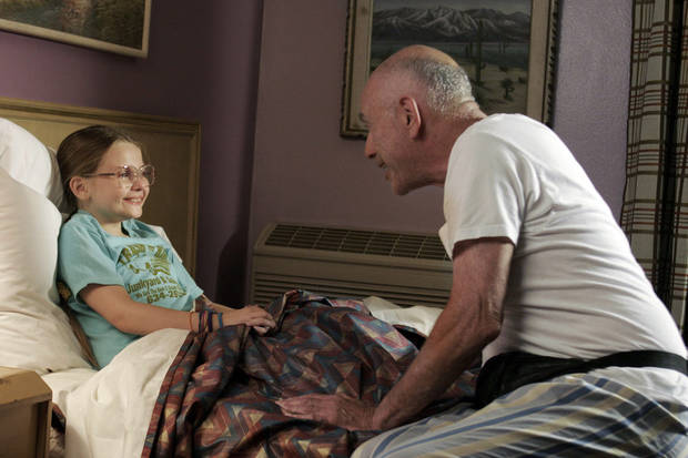 "FILE - This publicity file photo released by Fox Searchlight Pictures shows actors, Abigail Breslin, left, and Alan Arkin in a scene from ""Little Miss Sunshine."" (AP Photo/Fox Searchlight Pictures, Eric Lee, File)"