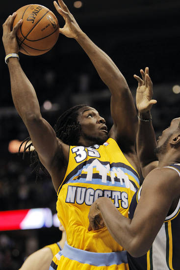 Denver Nuggets small forward Kenneth Faried (35) drives to the basket as he runs into Utah Jazz center Al Jefferson (25) during the first quarter of an NBA basketball game, Friday, Nov. 9, 2012, in Denver. (AP Photo/Barry Gutierrez)