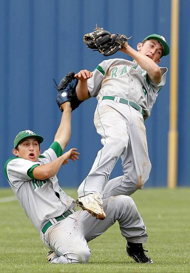 Rattan&#039;s Blake Watts, right, runs into AJ Davis after making a catch during the high school Class A baseball playoff game between Rattan and Pioneer at Dolese Park in Oklahoma City, Friday, May 4, 2012. Photo by Sarah Phipps, The Oklahoman