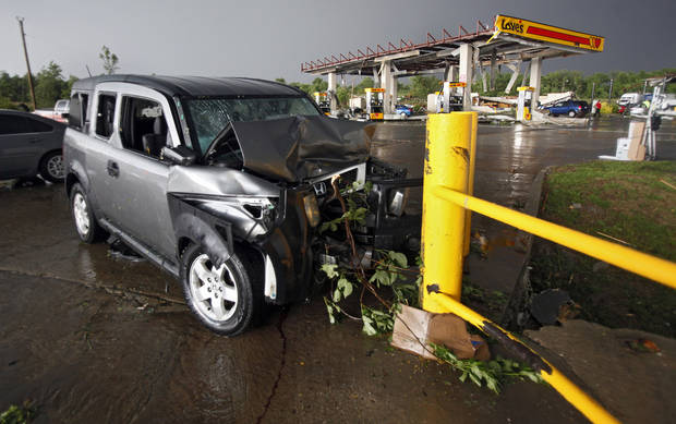 A car is damaged after being forced into a guardrail when a tornado damaged the area around I-40 and Choctaw Road on Monday, May 10, 2010, in Oklahoma City, Okla.  Photo by Chris Landsberger, The Oklahoman
