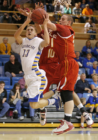 Bethel's Clint Simmons goes to the basket past Dale's Caleb Banks, right, and Jace Wilkins during their boys high school basketball game at Bethel High School in Shawnee, Okla., Friday, Feb. 1, 2013. Photo by Bryan Terry, The Oklahoman