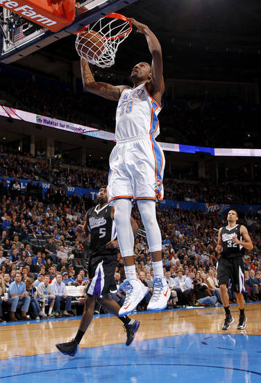 Oklahoma City's Kevin Durant (35) dunks the ball as Sacramento's John Salmons (5) and Francisco Garcia (32)  during an NBA basketball game between the Oklahoma City Thunder and the Sacramento Kings at Chesapeake Energy Arena in Oklahoma City, Friday, Dec. 14, 2012. Photo by Bryan Terry, The Oklahoman