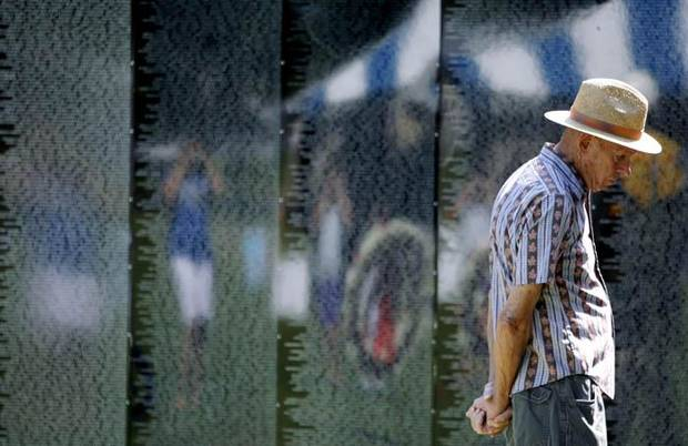 James Krick, a veteran from Shawnee, Okla., looks at The Moving Wall exhibit, a replica of Vietnam Veterans Memorial in Washington DC, at  Woodland Park in Shawnee , Okla., on Sunday, August 23, 2009. By John Clanton, The Oklahoman ORG XMIT: KOD