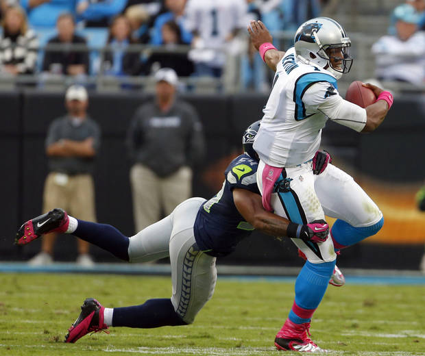 Carolina Panthers' Cam Newton (1) is tackled by Seattle Seahawks' Bobby Wagner (54) during the first quarter of an NFL football game in Charlotte, N.C., Sunday, Oct. 7, 2012. (AP Photo/Bob Leverone)