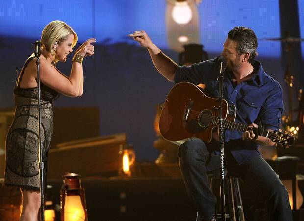 Gwen Sebastian, left, and Blake Shelton perform on stage at the 49th annual Academy of Country Music Awards at the MGM Grand Garden Arena on Sunday, April 6, 2014, in Las Vegas. (AP)