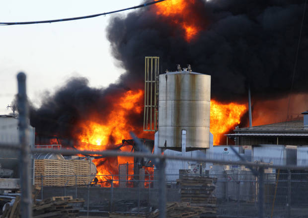 Firefighters allow a chemical fire to burn off at the Nexeo Solutions plant in Garland, Texas, on Friday, Nov. 16, 2012. Fire Capt. Merrill Balanciere says it's still unclear what caused the fire, but the flames were fueled by highly flammable toluene and methanol. All 41 workers who were at the plant at the time of the fire are safe. (AP Photo/The Dallas Morning News, Louis DeLuca) MANDATORY CREDIT; MAGS OUT; TV OUT; INTERNET OUT; AP MEMBERS ONLY