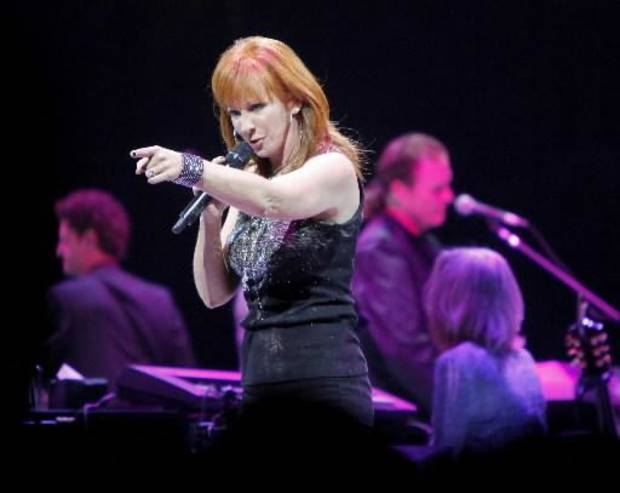 Reba McEntire, who hails from Chockie, and fellow country music superstar George Strait brought their blockbuster tour to Oklahoma City Arena on Saturday. (Photos by Bryan Terry, The Oklahoman)