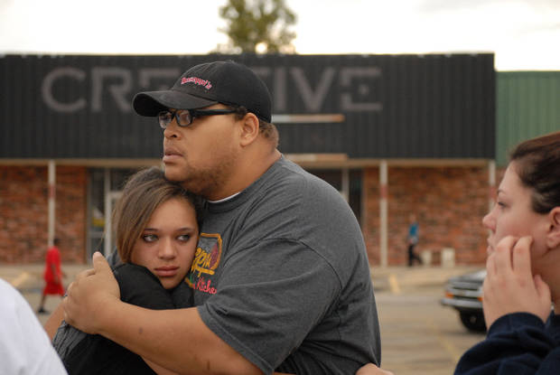 Lorenzo Cook hugs Silvia Cook at Cimarron Plaza in Stillwater. Students were taken there to meet their parents following a suicide at Stillwater Junior High School. PHOTO BY JONATHAN SUTTON, FOR THE OKLAHOMAN