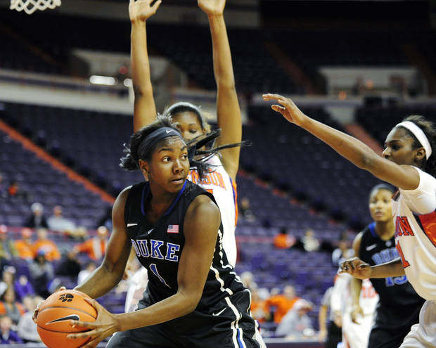 Duke's Elizabeth Williams looks to pass under pressure from Clemson's Nylilah Jamison-Myers, rear, and Nikki Dixon during the first half of an NCAA college basketball game, Thursday, Jan. 24, 2013, in Clemson, S.C. (AP Photo/Richard Shiro)