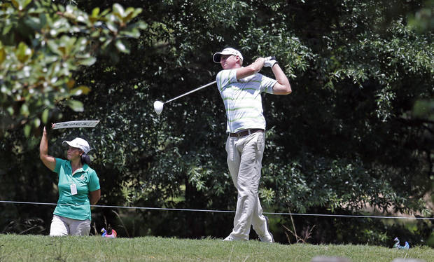 Vaughn Taylor tees off on the third hole during the second round of the Sanderson Farms Championship golf tournament, Friday, July 19, 2013 in Madison, Miss. (AP Photo/Rogelio V. Solis)