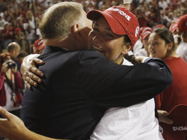 University of Oklahoma President Boren congratulates an Oklahoma softball player after Oklahoma defeated Tennessee 4-0 on June 4, 2013 to win the NCAA championship. Photo by KT KING, The Oklahoman