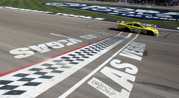 Matt Kenseth crosses the start/finish line to win the NASCAR Sprint Cup Series auto race on Sunday, March 10, 2013, in Las Vegas. (AP Photo/Isaac Brekken)