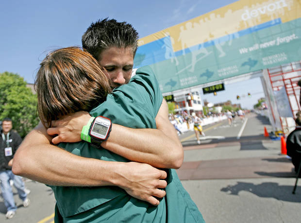 Brendan Brustad gets a hug after finishing the Oklahoma City Memorial Marathon, Sunday, April 27, 2008. Brustad ran a total 168 miles including the marathon to honor those killed in the Oklahoma City bombing. BY BRYAN TERRY, THE OKLAHOMAN
