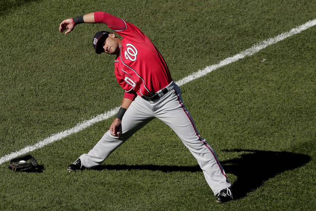 Washington Nationals shortstop Ian Desmond warms up before Game 2 of the National League division baseball series against the St. Louis Cardinals, Monday, Oct. 8, 2012, in St. Louis. (AP Photo/Charlie Riedel)