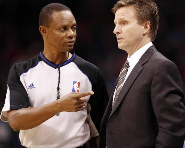 Oklahoma City coach Scott Brooks talks with the official during opening night of the Oklahoma City  Thunder NBA game against the Sacramento Kings at the Ford Center on Wednesday, Oct. 28, 2009, in Oklahoma City, Okla. Photo by Chris Landsberger